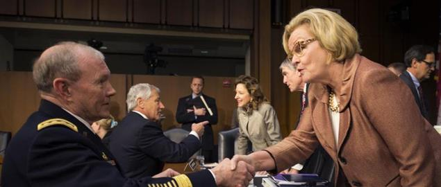Chairman of the Joint Chiefs of Staff  Martin E. Dempsey greets Senator McCaskill in 2013