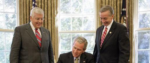 George W. Bush; Mike Enzi; and Geoff Davis